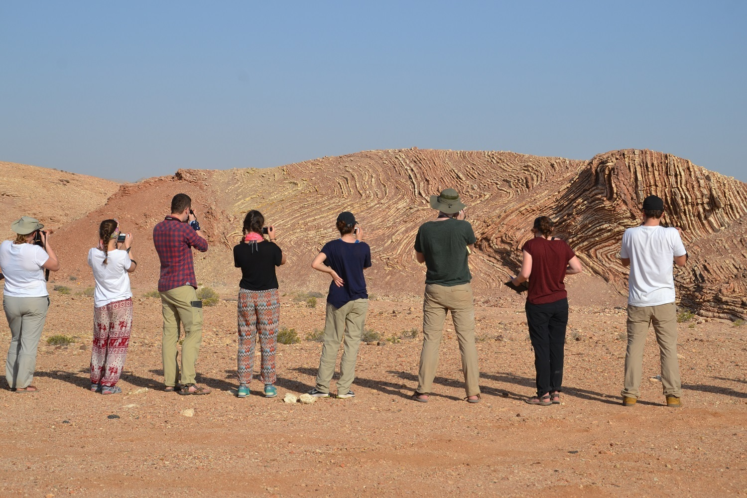 students taking pictures_outcrop Oman